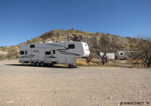 View of RV's parked by the hill.